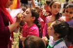 Children get their faces painted during SOHRAM-CASRA's annual picnic in Turkey