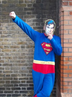 One of the numerous 'fancy dressed' Supermans outside a nearby hotel. The costumes that pass by our offices bring humour to FFT staff, in contrast to their work.