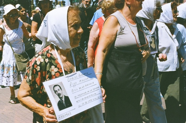 Mother of Plaza de Mayo, Argentina, began marching in 1977 to find out what happened to their children and grandchildren during the regime. Photo by lazy tired, available on Flickr through Creative Commons