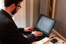 A member of the Comms team prepares the presentation pieces