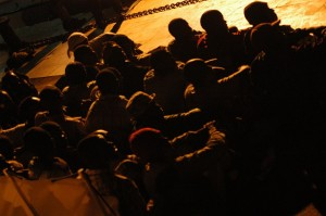 A boat of migrants arrives on the island of Lampedusa. Picture courtesy of No Borders Network, used under Flickr Creative Commons licence.