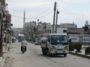 A central street of Ma'arrat, marked by barrel bombs and shelling