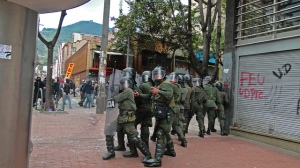 Police controlling unrest in Bogota (used courtesy of  Antena Mutante under Flickr creative commons licence)