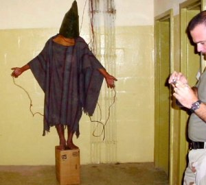 One of the most haunting and famous pictures from Abu Ghraib