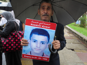 Ambarek Hamdani holds up a sign picturing his son, Djamel, who disappeared during Algeria's civil war. © 2014 Eric Goldstein/Human Rights Watch