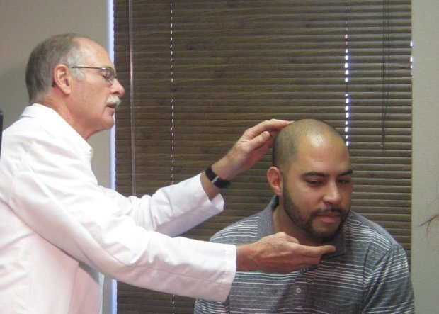 Demonstrating a medical examination.