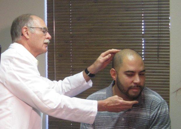 Demonstrating a medical examination.