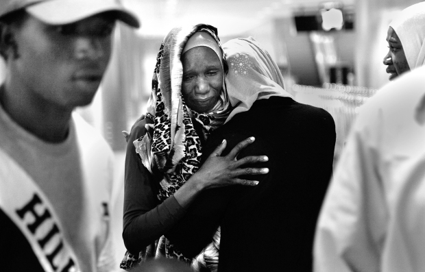 SAN DIEGO, CA-NOVEMBER 09, 2015: | A Sudanese refugee is greeted by her family where they reunited at Lindbergh Airport in San Diego for the first time in years. At 23, she arrived with her two young boys. | (Misael Virgen/ San Diego Union-Tribune)